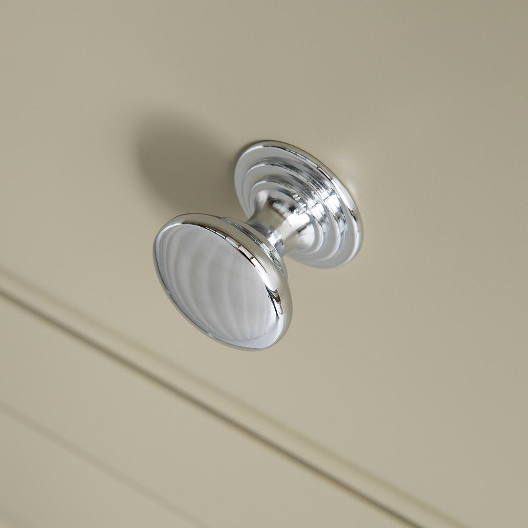Close up of the round metal drawer handles on the Chichester Green Small Sideboard