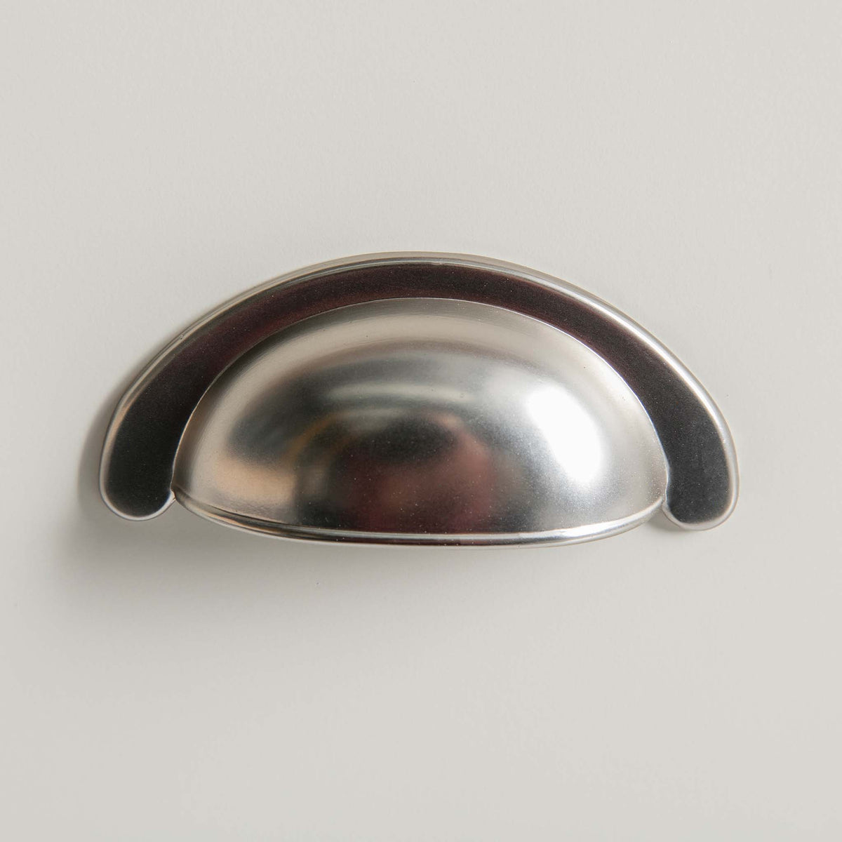 Close up of the silver metal cup handle on The Padstow White Solid Wood Coffee Table