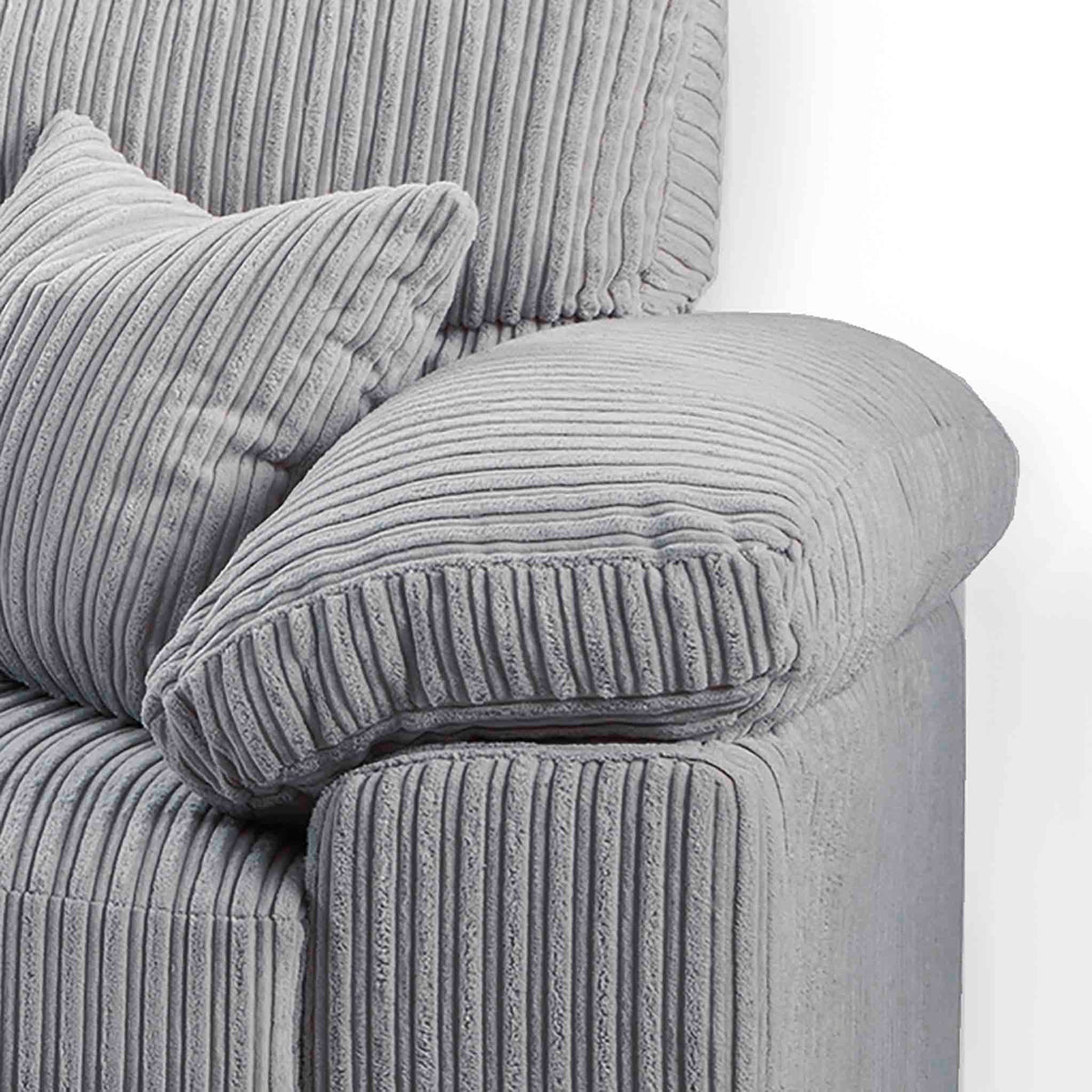 close up of the chunky cushioned armrests on the Amalfi Silver Corner Fabric Sofa