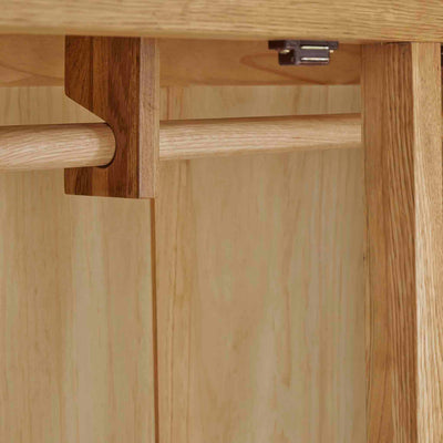 Zelah Oak Large Triple Wardrobe with Drawers - Close up of hanging rail fixings