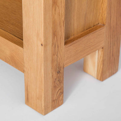 close up of solid wood legs on Surrey Oak Slim Bookcase