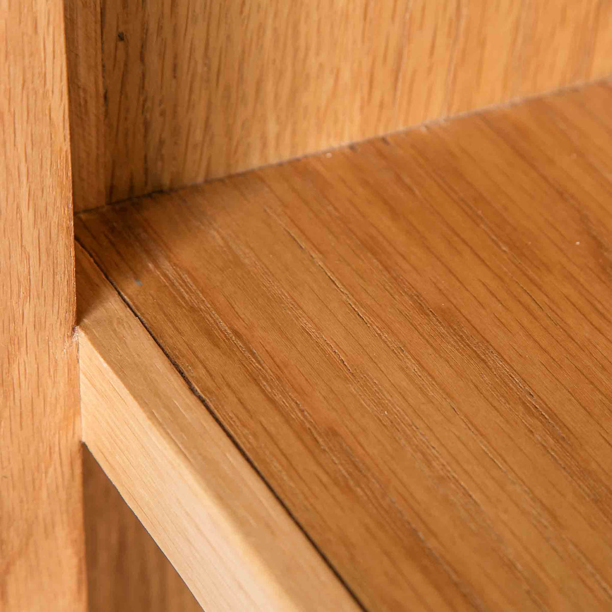 close up solid wood frame on the Surrey Oak Slim Bookcase