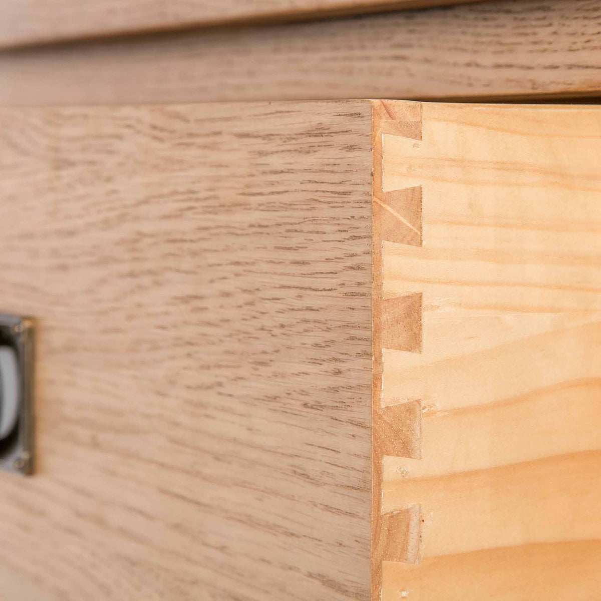 close up of dovetail joints for the Surrey Oak Large Chest Of Drawers