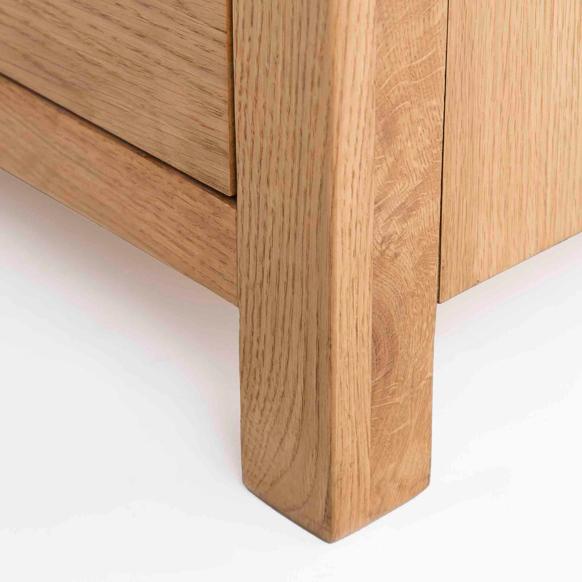 Surrey Oak Large Chest Of Drawers - Close up of foot of drawers