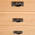 close up of brass drawer handles on the Surrey Oak 3 over 3 Chest Of Drawers