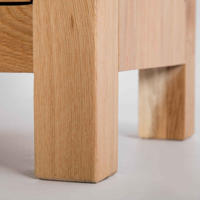 close up of solid oak legs on the London Oak 2 over 3 Chest of Drawers