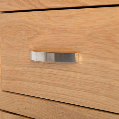 close up of contemporary metal handle on the London Oak Mini Sideboard by Roseland Furniture.