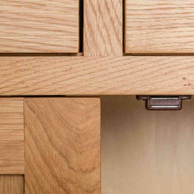 close up of the magnetic door catch on the London Oak Mini Sideboard by Roseland Furniture.