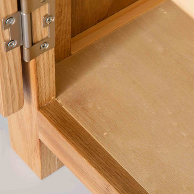 close up of the wooden base on the London Oak Mini Sideboard by Roseland Furniture.