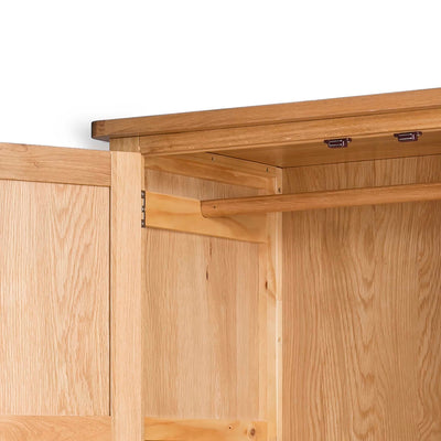Hampshire Oak Double Wardrobe with Drawer - Close up of hanging rail
