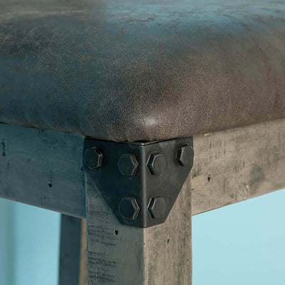 close up of exposed metal bolt details on the Brooklyn Cross Back Bar Stool