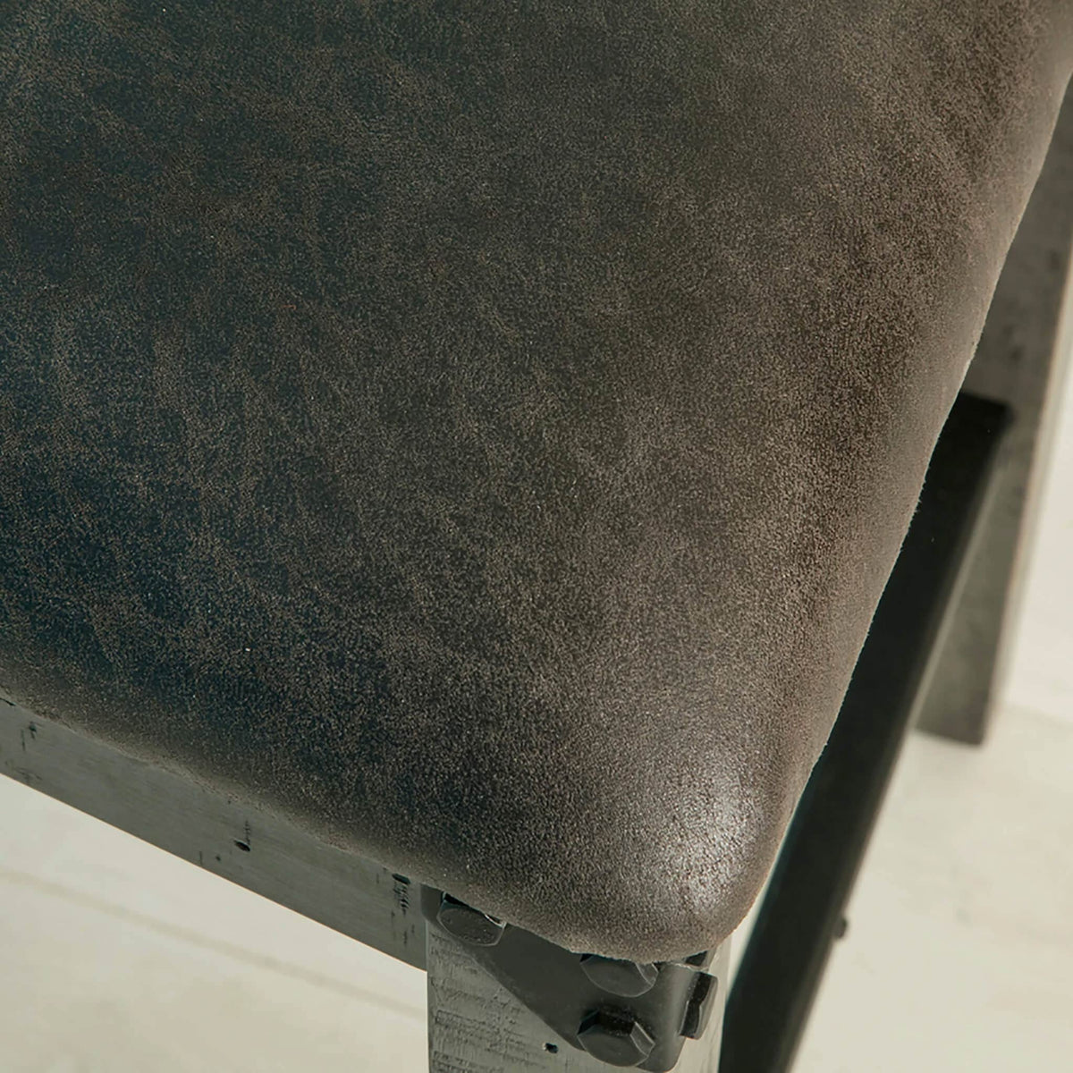 close up of soft faux leather seat on the Brooklyn Cross Back Bar Stool