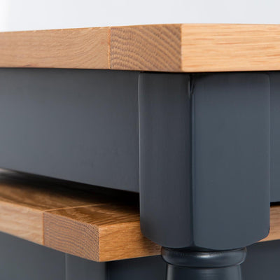 Close up of the black painted wooden frame on the Chichester Charcoal Nest of Tables