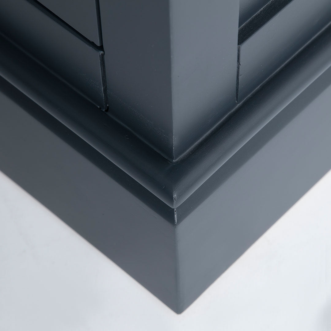 Close up of the black painted plinth base on the Chichester Charcoal Small Sideboard