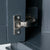Close up of the cabinet door hinge on the Chichester Charcoal Black Corner Cupboard