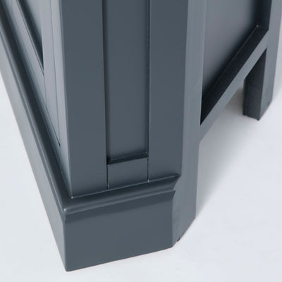 Close up of the solid wood corner base on the Chichester Charcoal Black Corner Cupboard