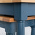 Close up of the painted blue solid wood frame on the Chichester Stiffkey Blue Nest of Tables