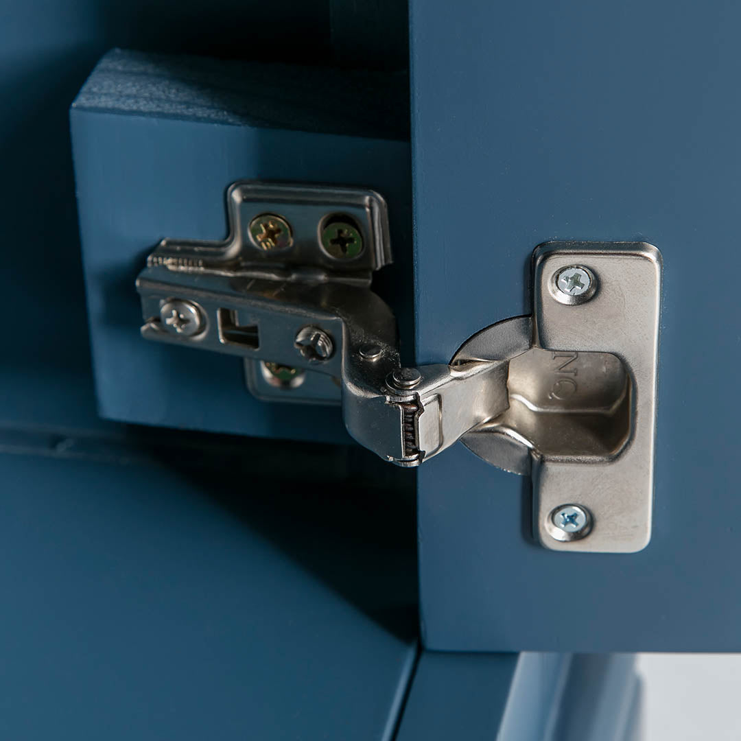 Close up of door hinge on the Chichester Stiffkey Blue Mini Cupboard