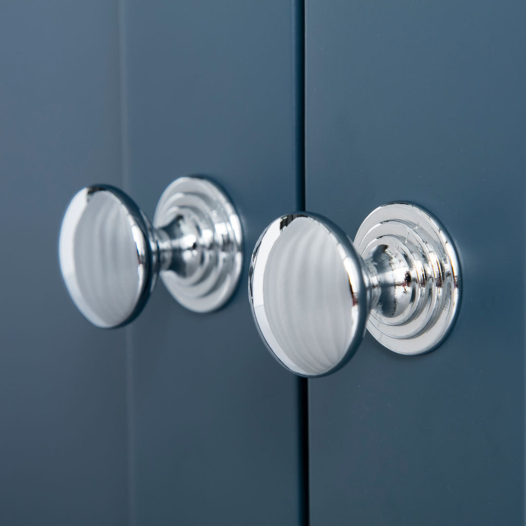 Close up of the silver door handles on the Chichester Stiffkey Blue Corner Cupboard