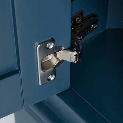 Close up of the door hinge on the Chichester Stiffkey Blue Corner Cupboard