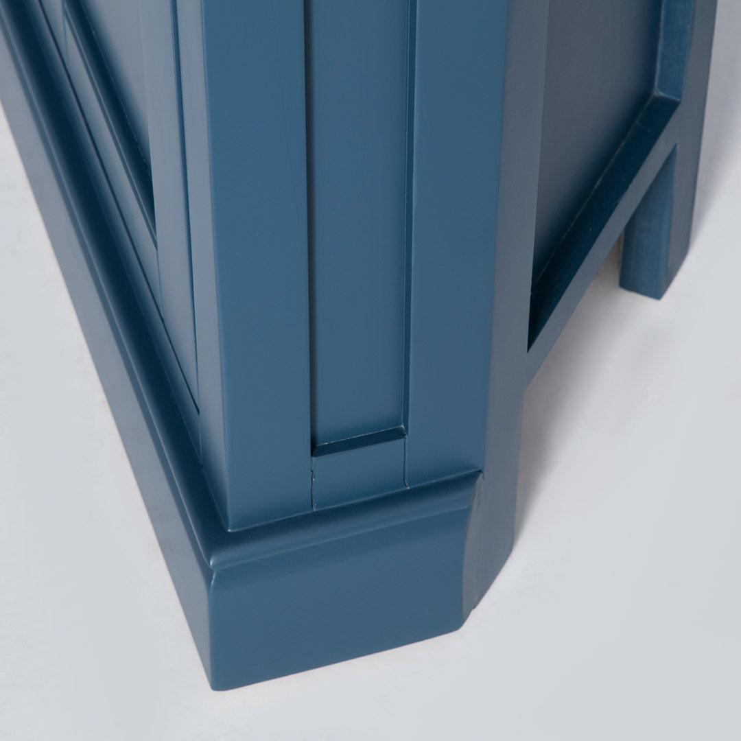 Side view of the solid wood base on the Chichester Stiffkey Blue Corner Cupboard