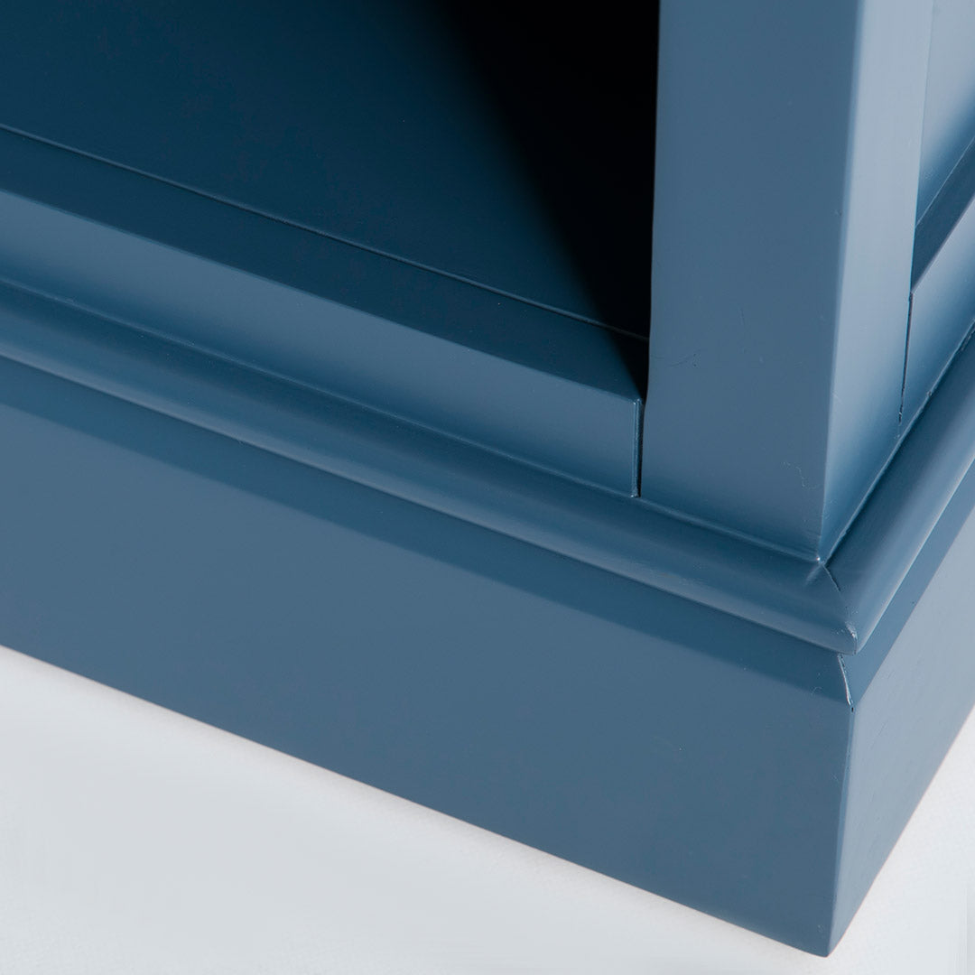 Close up of the blue painted wooden base on the Chichester Stiffkey Blue Grey Low Bookcase