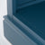 Close up of the blue painted lower shelf on the Chichester Stiffkey Blue Grey Low Bookcase