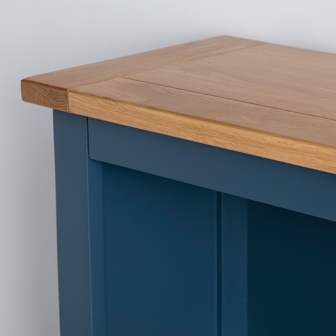 Close up of the oak top shelf on the Chichester Stiffkey Blue Grey Low Bookcase