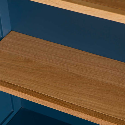 Close up of the oak shelves on the Chichester Stiffkey Blue Grey Low Bookcase