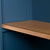 Close up of the wooden shelf edge on the Chichester Stiffkey Blue Grey Low Bookcase