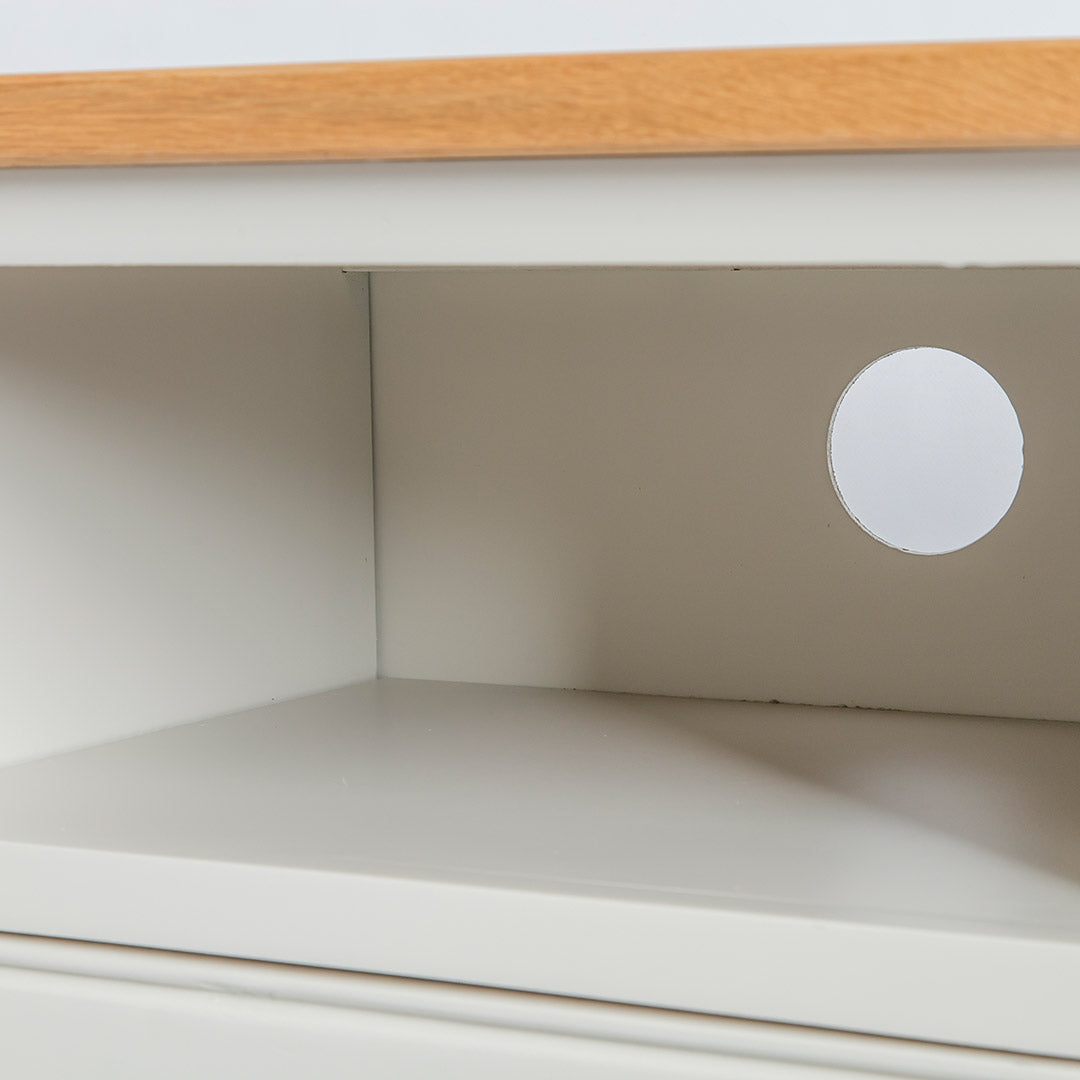 Close up of the open shelf on the Chichester Ivory Small TV Stand