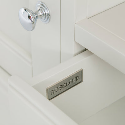 Close up of the metal Roseland drawer label on the Chichester Ivory Small TV Unit