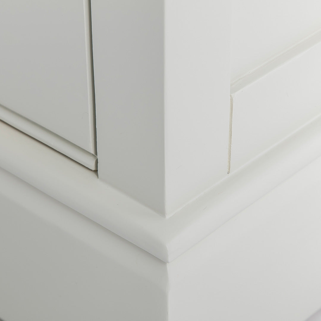 Close up of the plinth base on the Chichester Ivory Small TV Unit