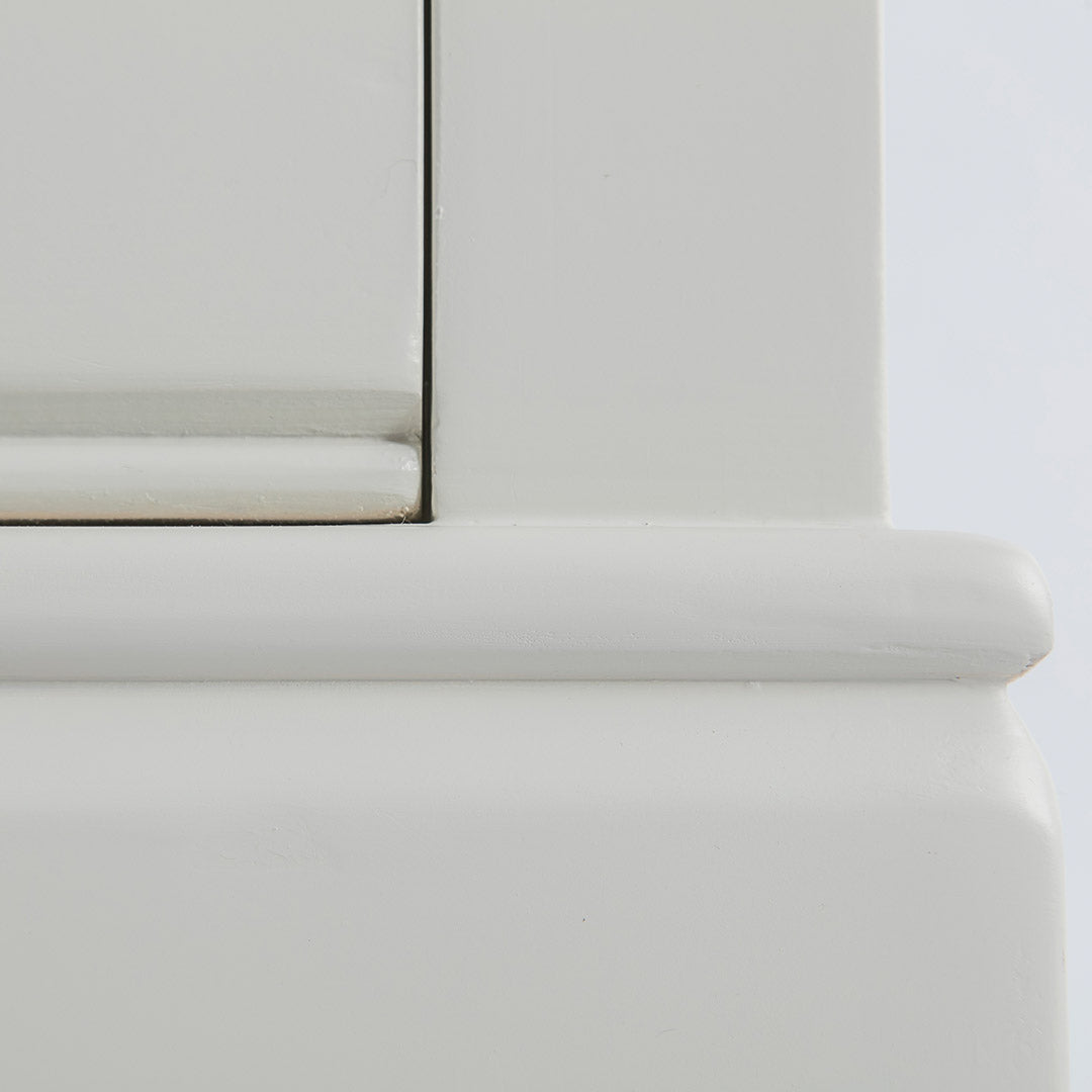 Close up of the painted solid wood frame on the Chichester Ivory Small TV Unit