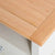 Close up of oak top on the Chichester Ivory Small TV Unit