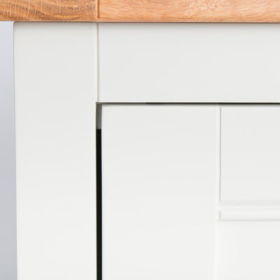 close up of the ivory paint on the Close up of oak top wood grain on the Chichester Ivory Cream Mini Cupboard