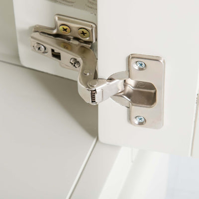 Close up of door hinge on the Chichester Ivory Cream Mini Cupboard