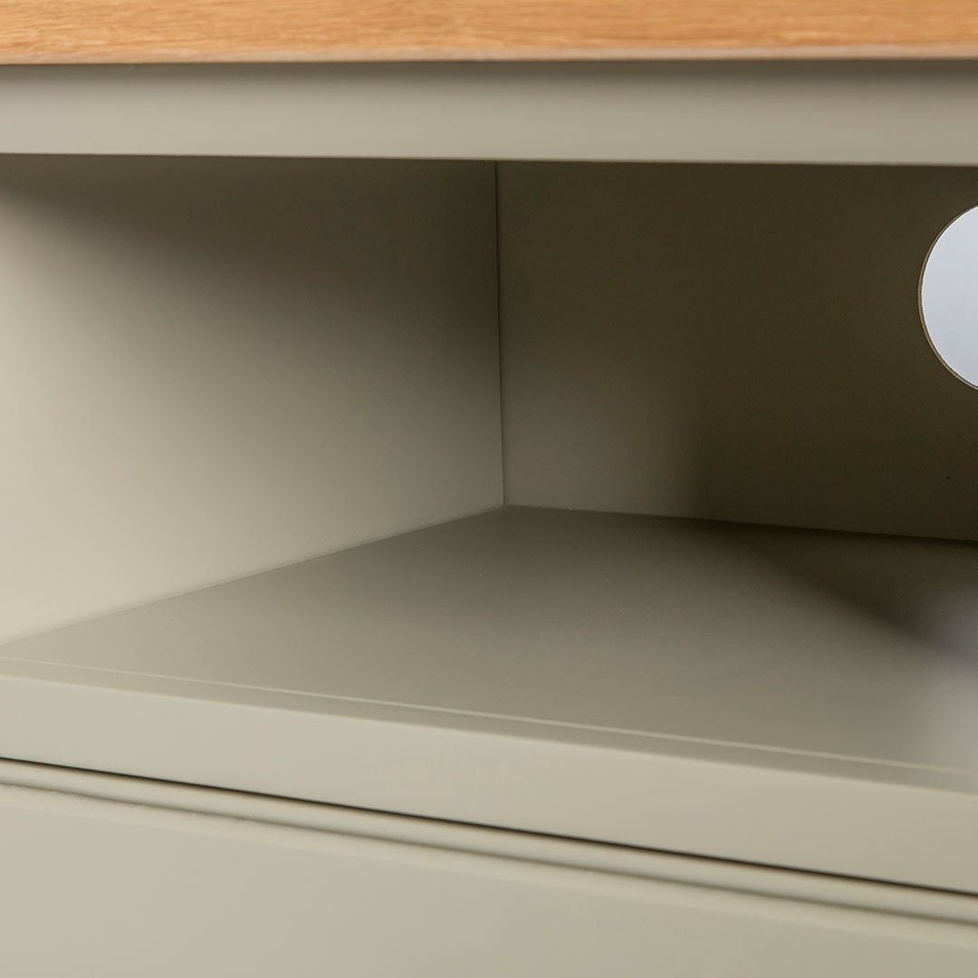 Close up of the open shelf on the Chichester Ledum Green Small TV Unit