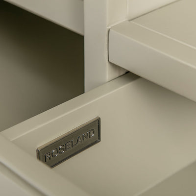 Close up of the metal Roseland drawer label on the Chichester Ledum Green Small TV Unit