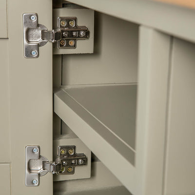 Close up of the cabinet door hinges on the Chichester Ledum Green Small TV Unit