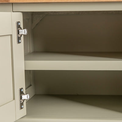 Close up of the cabinet fixed shelf on the Chichester Ledum Green Small TV Unit