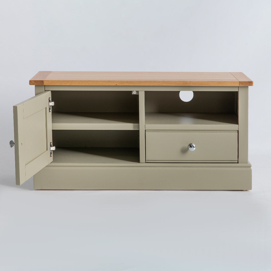 Opened cabinet door view of the Chichester Ledum Green Small TV Unit