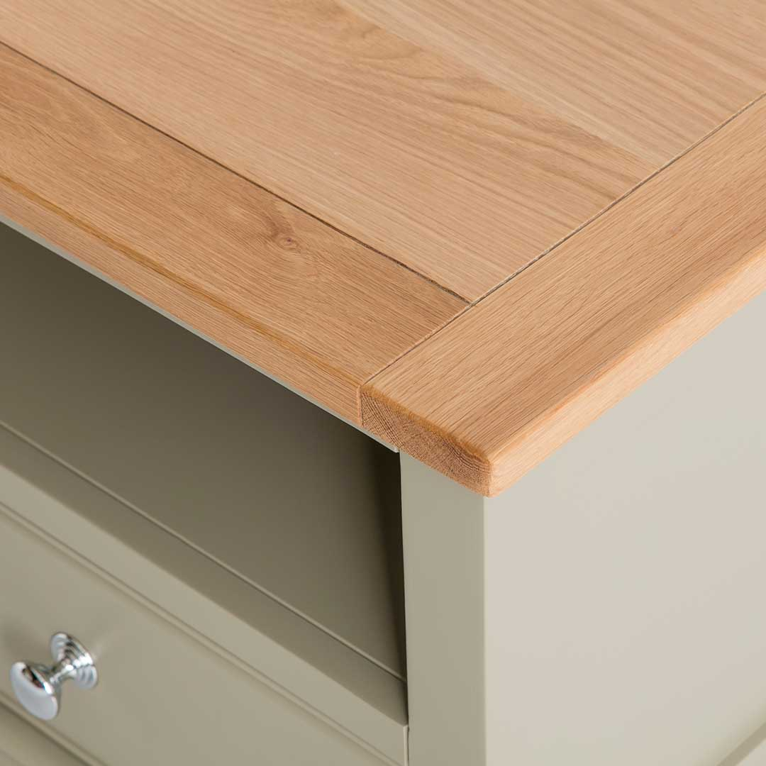 Close up of the oak top on the Chichester Ledum Green Small TV Unit