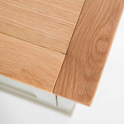 Close up of the oak top corner on the Chichester Ledum Green Mini Cupboard