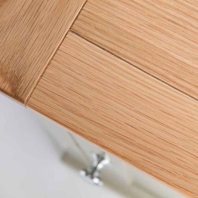 Close up of the oak top wood grain on the Chichester Ledum Green Mini Cupboard
