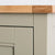 Close up of the oak top edge on the Chichester Ledum Green Mini Cupboard
