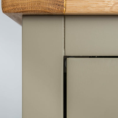 Close up of the painted green solid wood frame on the Chichester Ledum Green Mini Cupboard