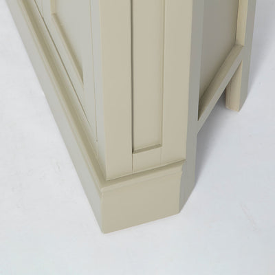 Side view of the plinth base on the Chichester Ledum Green Corner Cupboard