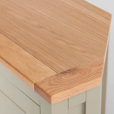 Close up of the oak top on the Chichester Ledum Green Corner Cupboard