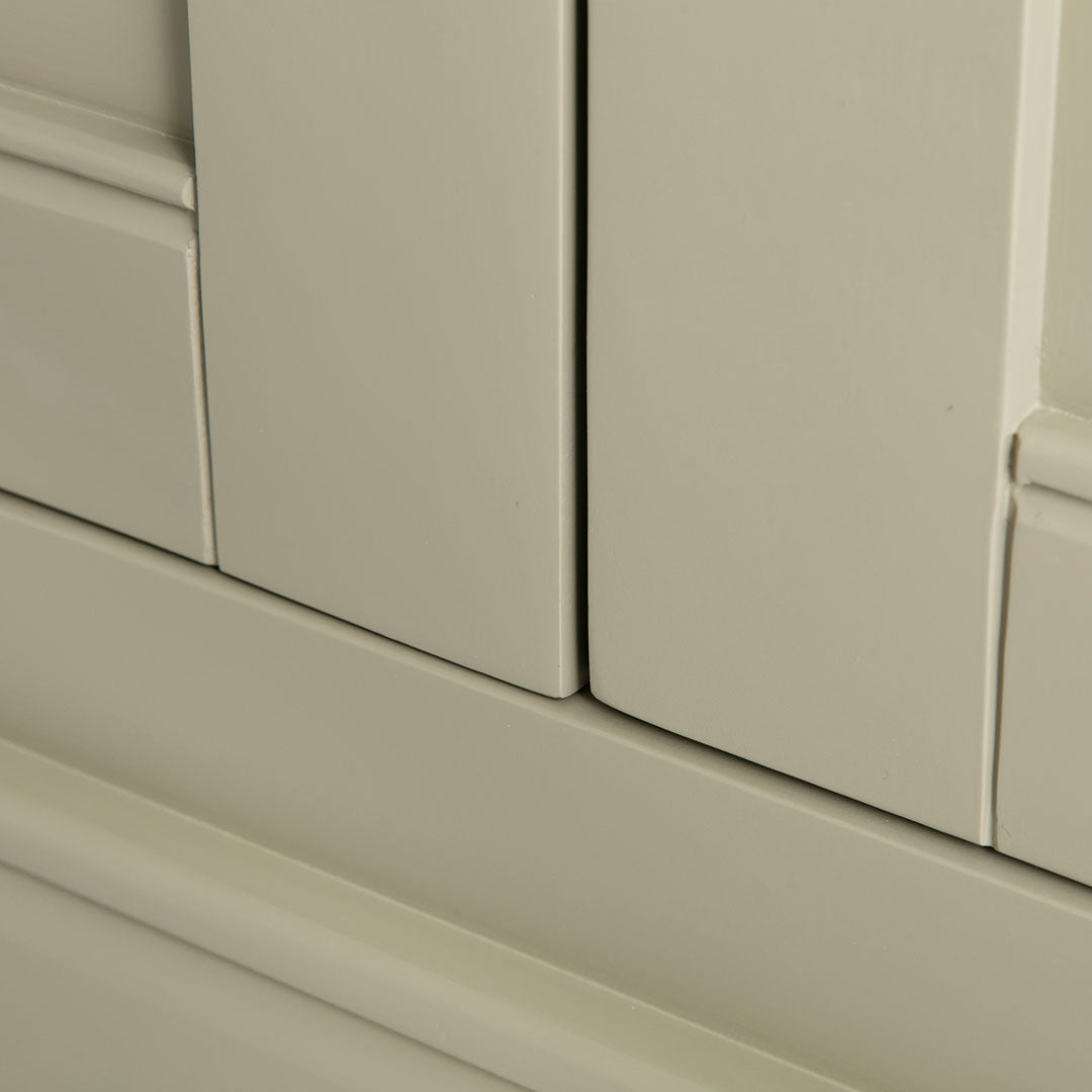 Close up of the painted green solid wood frame on the Chichester Ledum Green Corner Cupboard